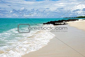 Tropical Beach and cloudy blue sky