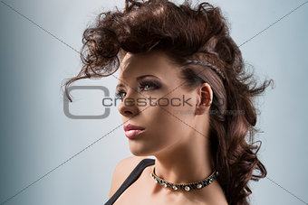 portrait of cute girl with creative hair-style