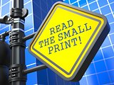 Roadsign with  'Read the Small Print' Concept.