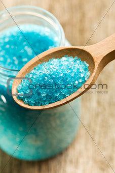 blue bath salt in wooden spoon