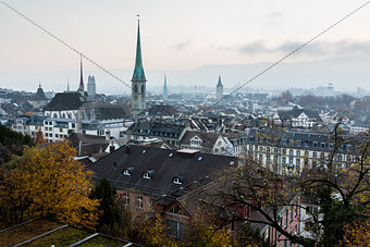 Aerial View on Tiled Roofs and Churches of Zurich at Fall, Switz