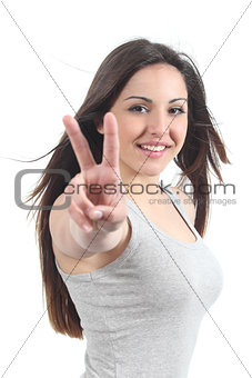 Beautiful teenager making the victory or peace gesture