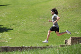 Sportsman running and jumping in a park