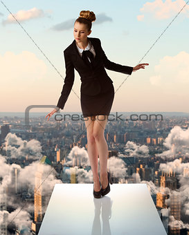 young business woman on trampoline