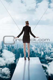 business woman turned back on trampoline