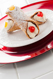 Two Tasty Cannoli on Plate