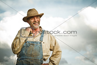 1930s farmer smiling at the Sun