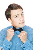 Handsome old-fashioned gentleman adjusting his bow tie