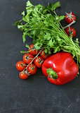 still life of fresh vegetables (tomatoes, mushrooms, peppers, cucumbers) on the blackboard