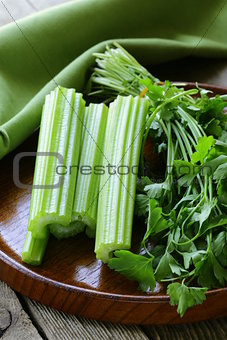 fresh celery sticks on a wooden table, rustic style