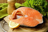 fresh raw red fish (salmon) on a cutting board
