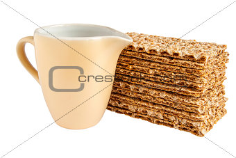 Milk jug and sesame crispbreads