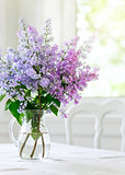 bunch lilac flowers in vase on table