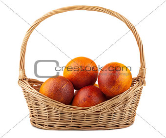 Blood red oranges in wicker basket