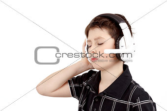 Portrait of a happy young boy listening to music on headphones