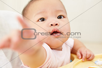 Baby reaching to camera