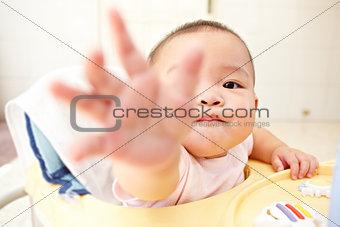 Baby reaching to camera