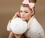 Pure Beauty. Woman in White Fluffy Knitted Pullover with Hank of Thread