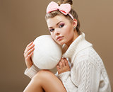 Hosiery. Beautiful Teen in Handmade Woven Sweater with White Ball of Yarn