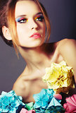 Portrait of Young Beauty with Colorful Origami Flowers. Bright Eye Make-Up