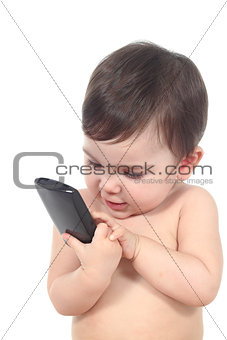 Beautiful baby playing with a smart phone