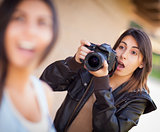 Excited Female Mixed Race Photographer Spots Celebrity