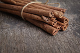 cinnamon sticks on old wooden table