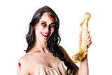 Halloween zombie holding human bone