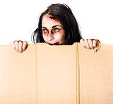 Zombie woman peering out cardboard box