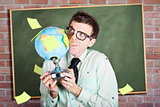 Nerd man holding earth world globe in classroom