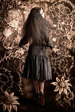Fairy tale girl walking through secret garden