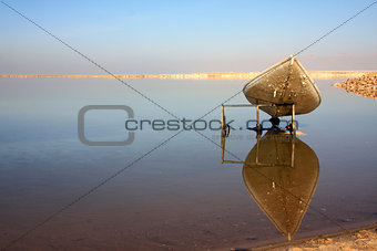 Dead Sea view with a canoe and reflection