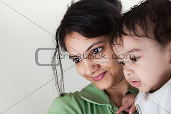 Indian mother and baby smiling