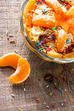 cream dessert orange fruit wooden board