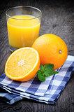 Glass of orange juice and fresh fruits