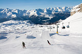 Snowboarders in a snowpark