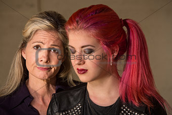 Apologetic Mother and Daughter
