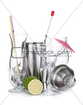 Cocktail shakers, glasses, utensils and lime
