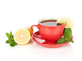 Red tea cup with lemon and mint