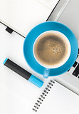 Blue coffee cup and office supplies