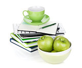 Ripe green apples, coffee cup and office supplies