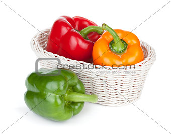 Green, red and orange bell peppers