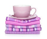 Coffee cup over kitchen towels