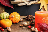 Autumn frame with pumpkins and candle