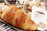 Breakfast with coffee, French croissant and jam