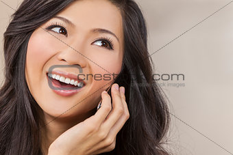 Beautiful Asian Chinese Woman Talking on Cell Phone