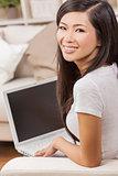 Beautiful Asian Chinese Woman Using Laptop Computer