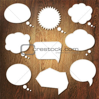 Abstract Speech Bubble On Wooden Background