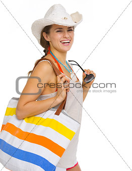 Portrait of smiling beach young woman in hat with sunglasses