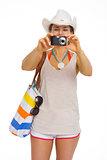 Beach young woman taking photo